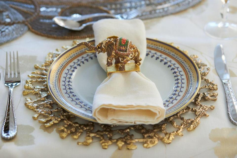 """<p>""""With spring's lighter mood, Easter is the perfect occasion to create a tablescape layered with a luxe and colorful mix of gold, cream, cobalt blue, and textured metal elements. I also like to include a whimsical conversation piece such as this delightful mahout napkin ring."""" <em>—<a href=""""https://www.doreenchambers.com/"""" rel=""""nofollow noopener"""" target=""""_blank"""" data-ylk=""""slk:Doreen Chambers"""" class=""""link rapid-noclick-resp"""">Doreen Chambers</a>, Interior Designer</em></p>"""