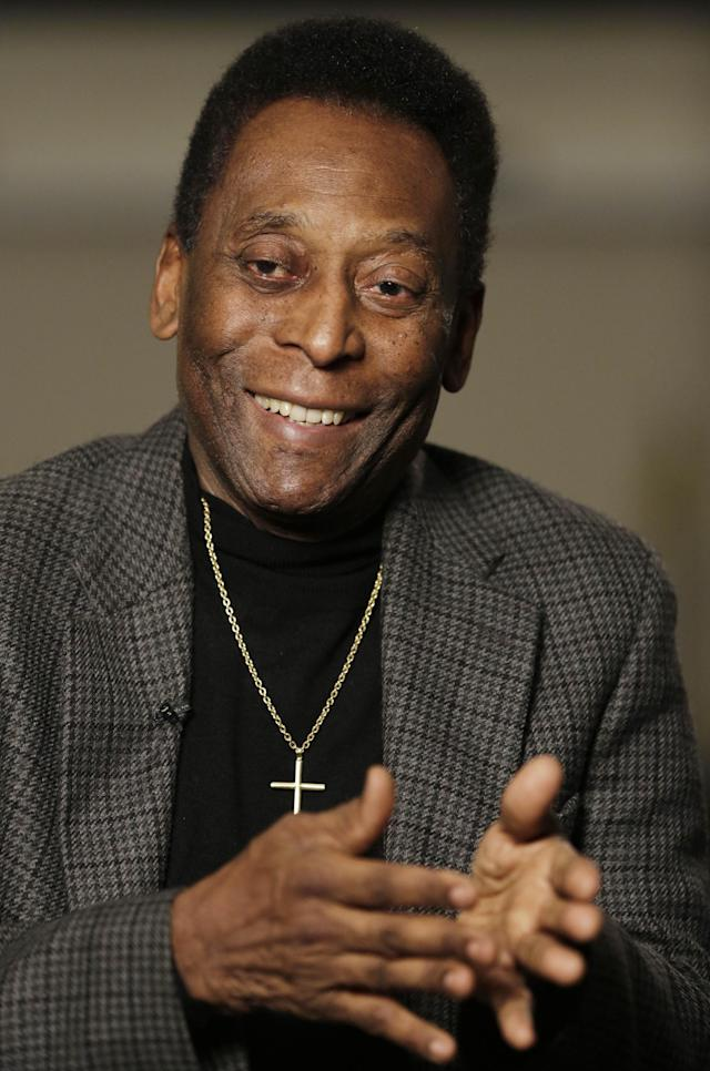 """In this Wednesday, April 2, 2014 photo, Edson Arantes do Nascimento, better known as Pele, is interviewed at The Associated Press in New York. The retired Brazilian soccer star played on three winning World Cup teams in 1958, 1962, and 1970. As soccer's showcase returns to the land of """"jogo bonito"""" (the beautiful game), Pele's views are sought. (AP Photo/Mark Lennihan)"""