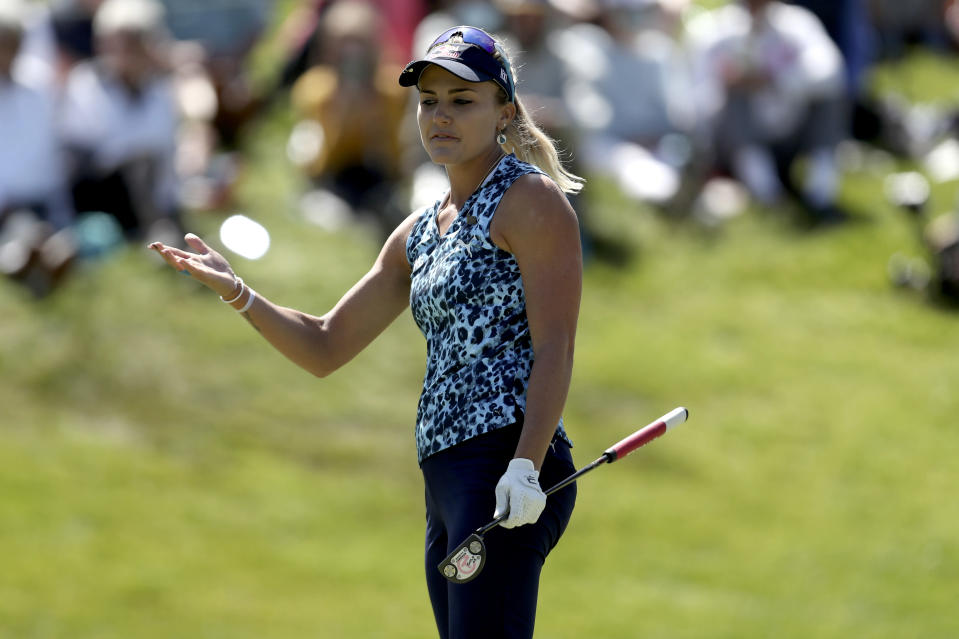 Lexi Thompson looks at her ball after bogeying the 18th hole during the final round of the U.S. Women's Open golf tournament at The Olympic Club, Sunday, June 6, 2021, in San Francisco. (AP Photo/Jed Jacobsohn)