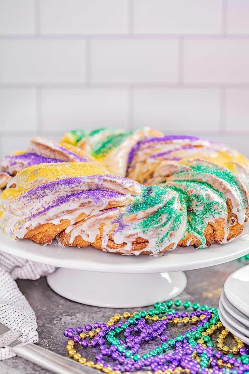 """<p>This delicious braided sweet bread is a Mardi Gras tradition for good reason! With sweet flavors, fun colors, and a baby in the middle, what's better?! This recipe includes three different shape options in case you want to try something new this year. Feel free to get creative!</p> <p><strong>Get the recipe</strong>: <a href=""""https://thestayathomechef.com/king-cake/"""" class=""""link rapid-noclick-resp"""" rel=""""nofollow noopener"""" target=""""_blank"""" data-ylk=""""slk:braided king cake"""">braided king cake</a></p>"""