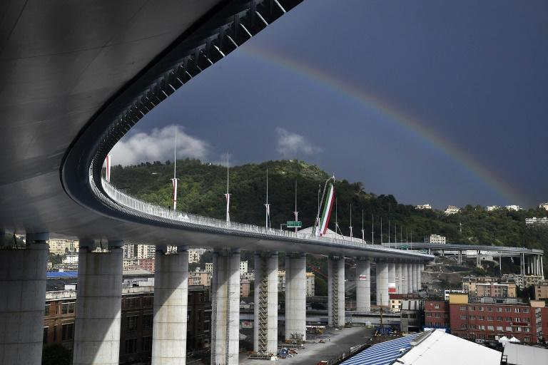 A rainbow appears above the new San Giorgio bridge on its inauguration. The high-tech structure will have four maintenance robots running along its length to spot weathering or erosion