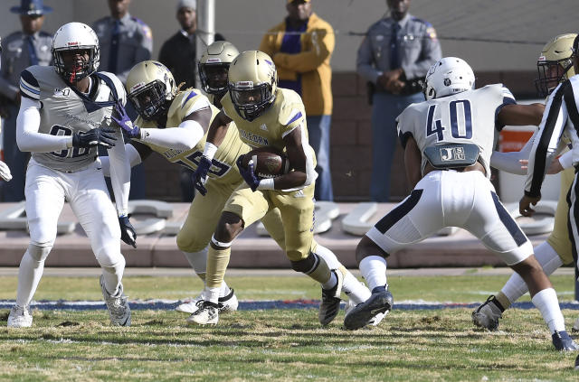 Alcorn State running back Niko Duffey (5) carries the ball on run against Jackson State during the first half of an NCAA college football game in Jackson, Miss., Saturday, Nov. 23, 2019. (Courtland Wells/The Vicksburg Post via AP)