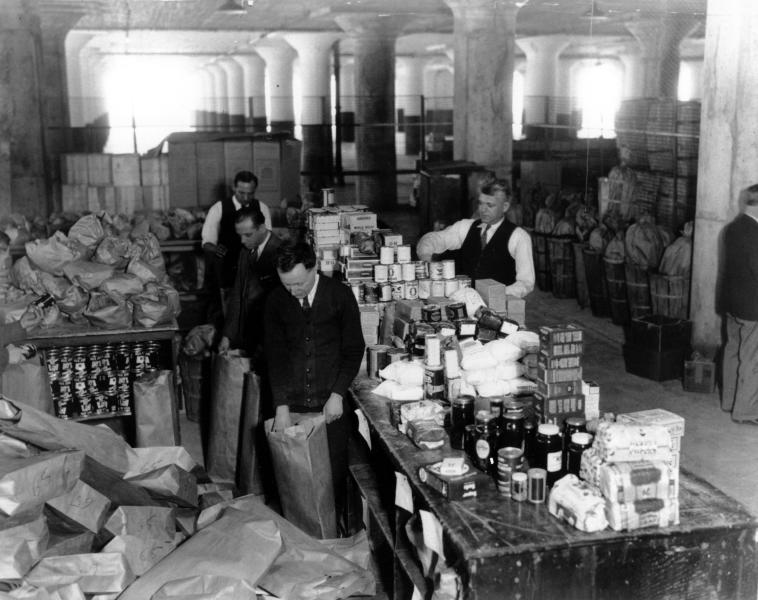 FILE - In this March 18, 1932, file photo workman sort individual 25-pound packages of unperishable food for needy families in New York City, where the The Emergency Unemployment Relief Committee established the central depot and share-a-meal drive to provide food during the Great Depression. Food stamps look ripe for the picking, politically speaking. Through five years and counting of economic distress, the food aid program has swollen up like a summer tomato. It grew to $78 billion last year, more than double its size when the recession began in late 2007. That makes it a juicy target for conservative Republicans seeking to trim spending and pare back government. But to many Democrats, food stamps are a major element of the country's commitment to help citizens struggling to meet basic needs. (AP Photo, File)