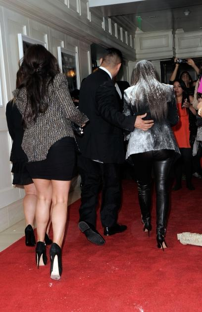 Kim Kardashian is covered in flour during arrivals at the 'True Reflection' Fragrance Launch at The London West Hollywood on March 22, 2012  -- Getty Images
