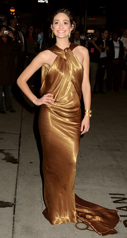 "Emmy Rossum's golden gown accentuates her lovely shoulders and lean arms. Janet Mayer/<a href=""http://www.splashnewsonline.com/"" target=""new"">Splash News</a> - October 22, 2009"