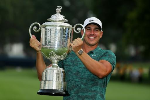 Brooks Koepka of the United States poses with the Wanamaker Trophy