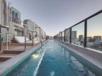 A new hotel on Sydney's historic Sussex Street has a rooftop bar and pool overlooking the city