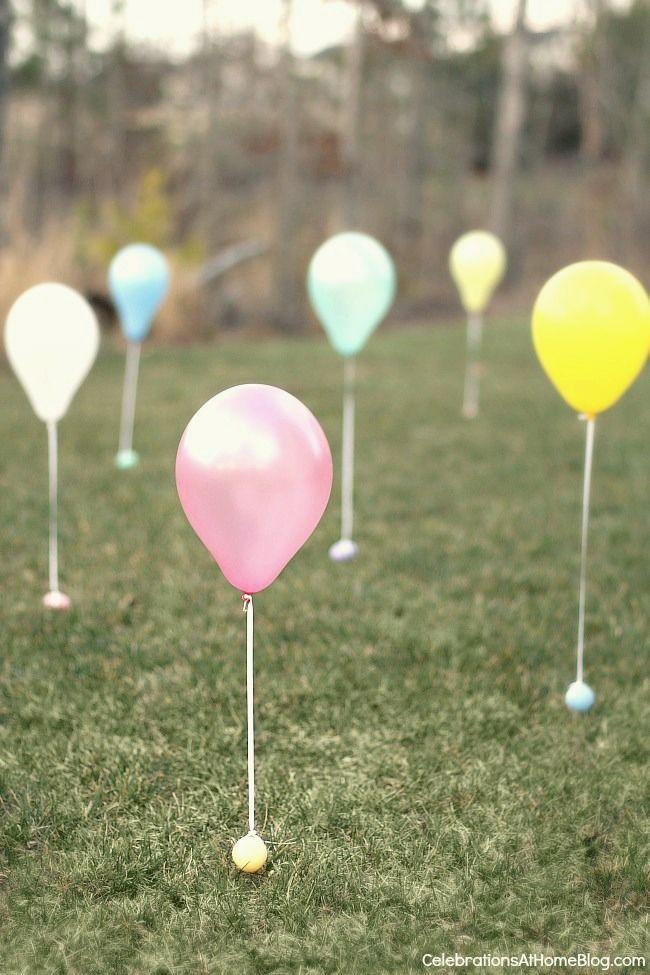 "<p>Create a mini ""minefield"" by tying a plastic egg onto the free end of a balloon string. Even the tiniest eyes won't miss 'em. </p><p><em><a href=""http://celebrationsathomeblog.com/easter-egg-hunt-idea/"" rel=""nofollow noopener"" target=""_blank"" data-ylk=""slk:Get the tutorial at Celebrations at Home »"" class=""link rapid-noclick-resp"">Get the tutorial at Celebrations at Home »</a></em></p>"