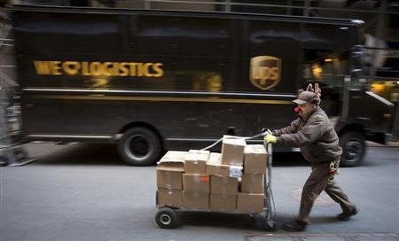 A UPS delivery man prepares to deliver packages on Christmas Eve in New York