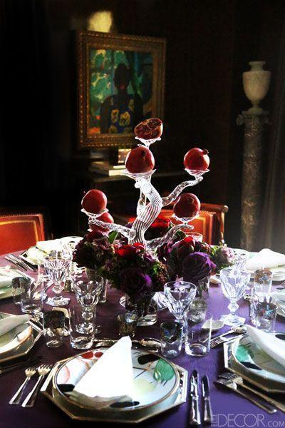 "<p>Every Christmas dinner table can benefit from a striking decorative accent. Here, designer Brian McCarthy used a glass tree sculpture—filled with holiday-appropriate pomegranates—as a conversation starter. While the centerpiece is quite tall, guests can still chat freely due to its translucence. </p><p><em><a href=""https://bjminc.com/"" rel=""nofollow noopener"" target=""_blank"" data-ylk=""slk:Via Brian J. McCarthy"" class=""link rapid-noclick-resp"">Via Brian J. McCarthy</a></em></p>"