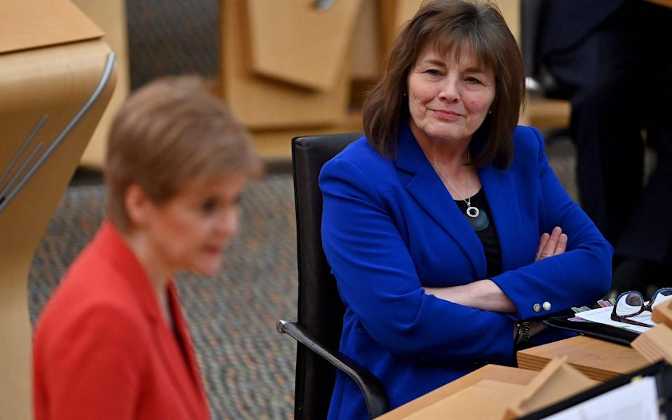 Jeane Freeman, right, confirmed the plan at Holyrood - JEFF J MITCHELL/AFP
