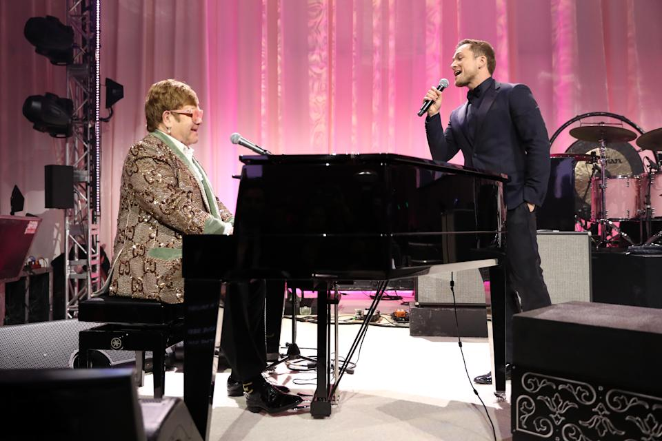 "Elton John and Taron Egerton sang a delightful surprise duet of ""Tiny Dancer"" Sunday night. (Photo: Getty Images for EJAF)"