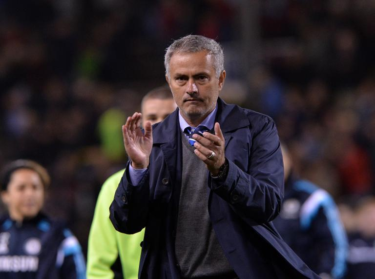 Chelsea's Portuguese manager Jose Mourinho applauds after the English Premier League match against Burnley at Turf Moor in Burnley, north west England on August 18, 2014 (AFP Photo/Paul Ellis)