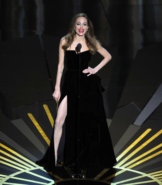 Angelina Jolie presents an award during the 84th Academy Awards on Sunday, Feb. 26, 2012, in the Hollywood section of Los Angeles. (AP Photo/Mark J. Terrill)