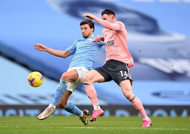 The signing of Ruben Dias (left) has transformed Manchester City's defence