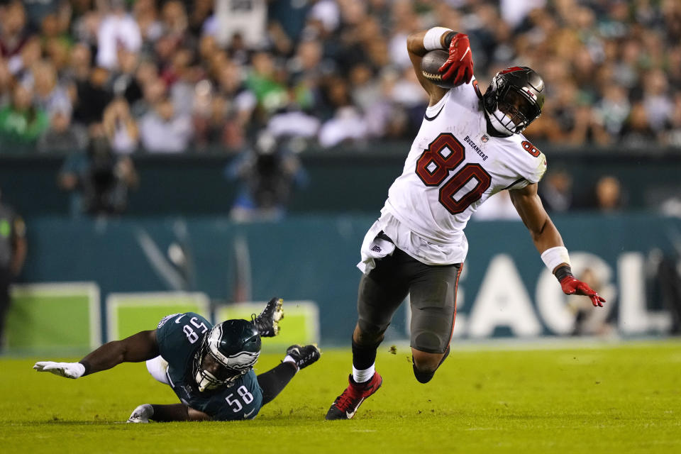 Tampa Bay Buccaneers tight end O.J. Howard (80) is stopped by Philadelphia Eagles outside linebacker Genard Avery (58) during the second half of an NFL football game Thursday, Oct. 14, 2021, in Philadelphia. (AP Photo/Matt Slocum)