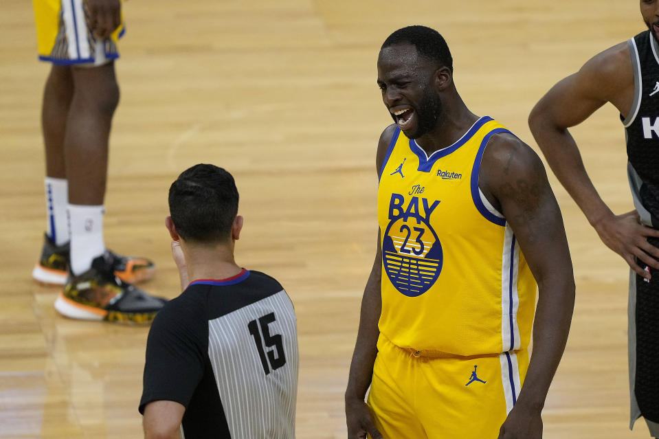 Golden State Warriors forward Draymond Green (23) argues with referee Zach Zarba (15) during the first half against the Sacramento Kings in an NBA basketball game on Sunday, April 25, 2021, in San Francisco. (AP Photo/Tony Avelar)