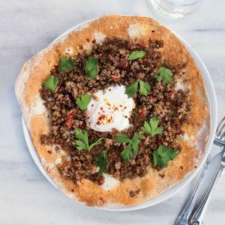 """<p>You won't find this at Pizza Hut.</p><p>Get the recipe from <a rel=""""nofollow"""" href=""""http://www.delish.com/cooking/recipe-ideas/recipes/a19243/turkish-ground-lamb-pizzas-recipe-fw0512/"""">Delish</a>.</p><p><em><strong>BUY NOW: Le Creuset Cast-Iron 12"""" Skillet, $200; </strong></em><em><strong><a rel=""""nofollow"""" href=""""https://www.amazon.com/Creuset-Signature-Handle-Skillet-4-Inch/dp/B00B4UOTBQ/?tag=syndication-20"""">amazon.com</a>.</strong></em><span></span><br></p>"""