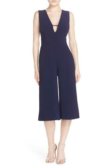 "Get it on <a href=""https://www.nordstromrack.com/shop/product/1938656/adelyn-rae-sleeveless-culotte-jumpsuit?color=NAVY"" target=""_blank"">Nordstrom Rack for $50</a>."