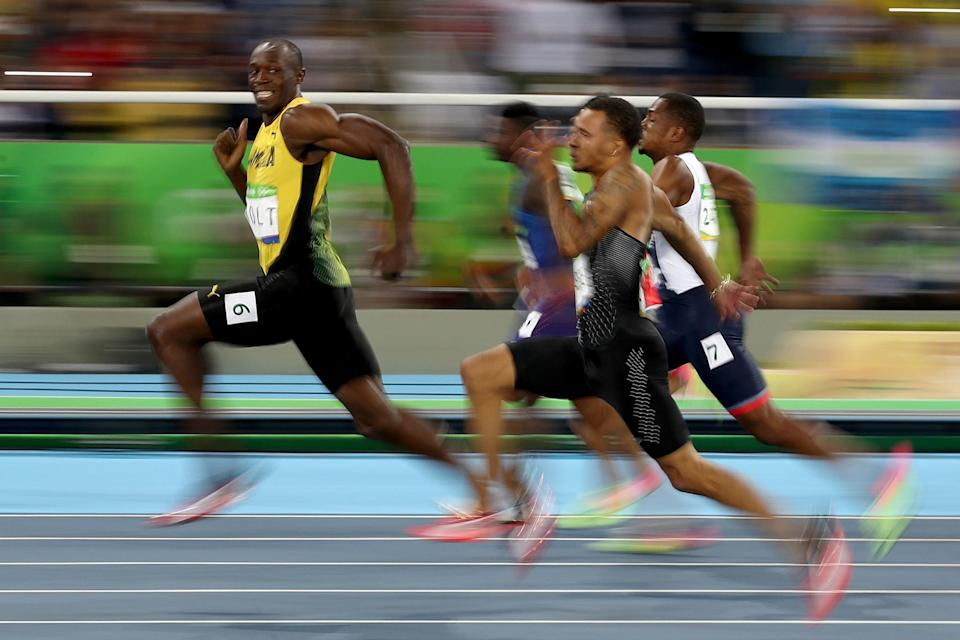 Cameron Spencer captured Usain Bolt smiling near the end of his semifinal race. Cameron Spencer/Getty Images)