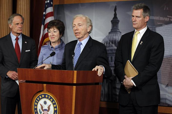 Sen. Joe Lieberman, I-Conn., Sen. Susan Collins, R-Maine., Sen. Scott Brown, R-Mass., and Sen. Tom Carper, D-Del., speak about the Postal Reform Bill on Capitol Hill in Washington, Wednesday, April 25, 2012. (AP Photo/Charles Dharapak)