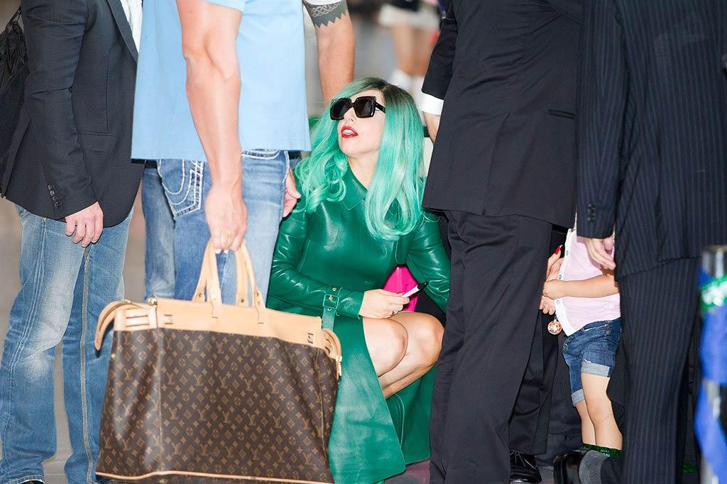 "Lady Gaga decided to go green for her arrival at Narita International Airport in Tokyo, Japan, where she was greeted by a crowd of about 200 fans -- including a very young ""little monster"" who managed to grab an autograph. Aflo/<a href=""http://www.splashnewsonline.com"" target=""new"">Splash News</a> - June 21, 2011"