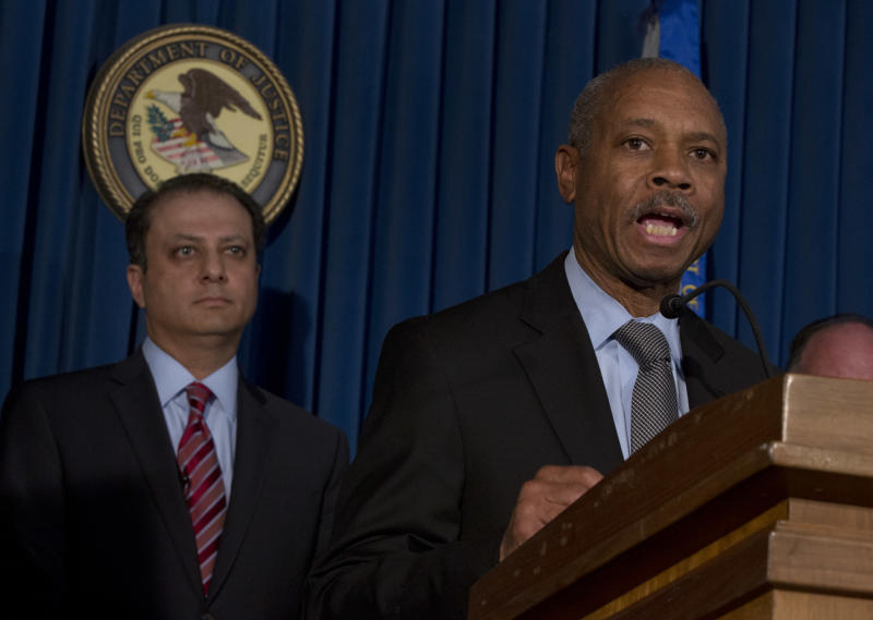 Bronx borough District Attorney Robert Johnson, right, addresses a news conference, accompanied by U.S. Attorney Preet Bharara, in New York, Thursday, April 4, 2013. New York state Assemblyman Eric Stevenson, a Democrat, was arrested in a bribery investigation that also led another state assemblyman charged with crimes to cooperate with the understanding that he would resign his position with the arrests of Stevenson and four other defendants.(AP Photo/Richard Drew)