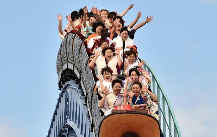 Japanese rollercoaster fans have been advised to 'scream inside your hearts' to prevent the spread of coronavirus (AFP Photo/KAZUHIRO NOGI)