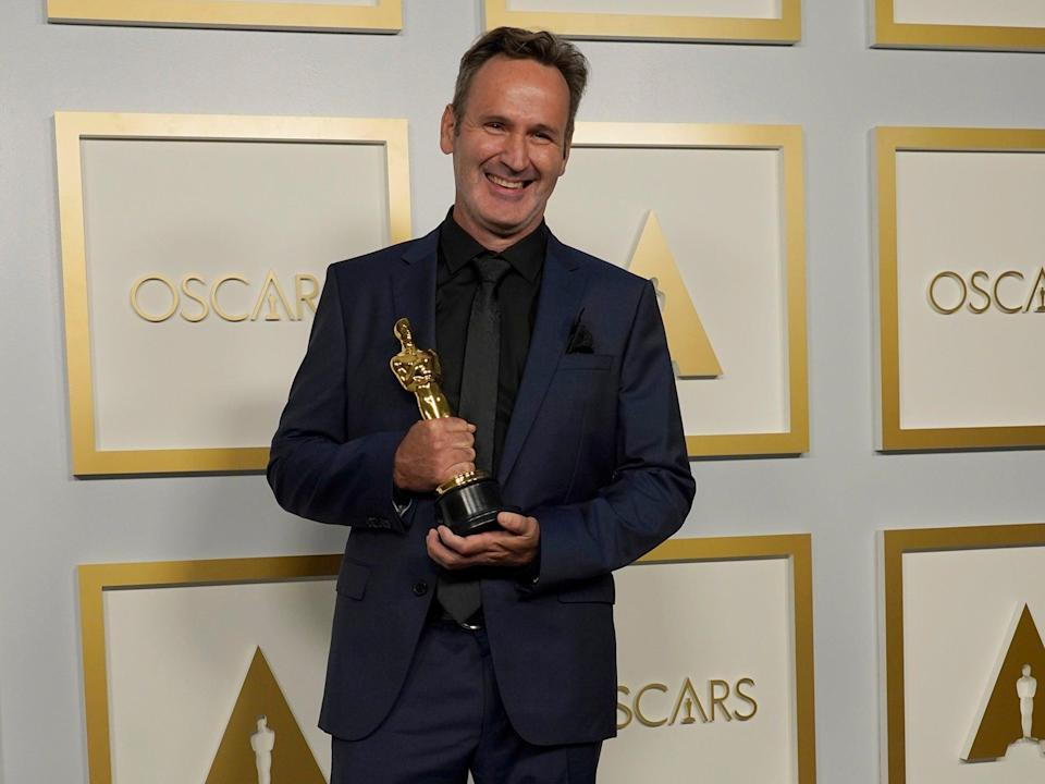 Scott R Fisherwith the award for Best Visual Effects for 'Tenet'AP