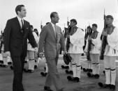 FILE - In this March 25, 1965 file photo, King Constantine II of Greece, left, and Prince Philip of Britain review an honor guard of the Greek Royal Evzones Guard as the prince arrives at the Athens Airport for a brief visit as the guest of the Greek royal family. Prince Philip's life spanned just under an entire century of European history. His genealogy was just as broad, with Britain's longest-serving consort linked by blood and marriage to most of the continent's royal houses. (AP Photo/Aristotle Saris, File)