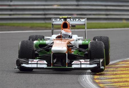 Force India Formula One driver Adrian Sutil of Germany takes a curve during the first practice session of the Belgian F1 Grand Prix at the Circuit of Spa-Francorchamps August 23, 2013. REUTERS/Laurent Dubrule