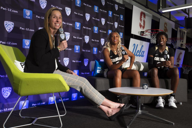 Colorado head coach JR Payne, from left, and players Quinessa Caylao-Do and Mya Hollingshead speak to reporters during the Pac-12 Conference women's NCAA college basketball media day, Monday, Oct. 7, 2019, in San Francisco.(AP Photo/D. Ross Cameron)