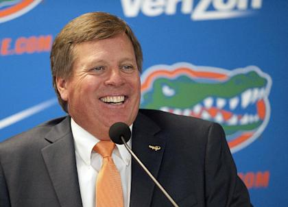 Jim McElwain speaks to the media during his introductory press conference at Florida. (AP)