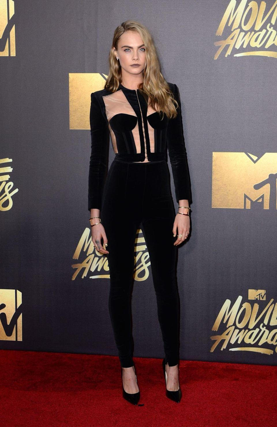 <p>Cara's earning less than last year (where she was number two on the big earner's list) but then she did temporarily 'retire' from the industry. <i>[Photo: PA]</i></p>