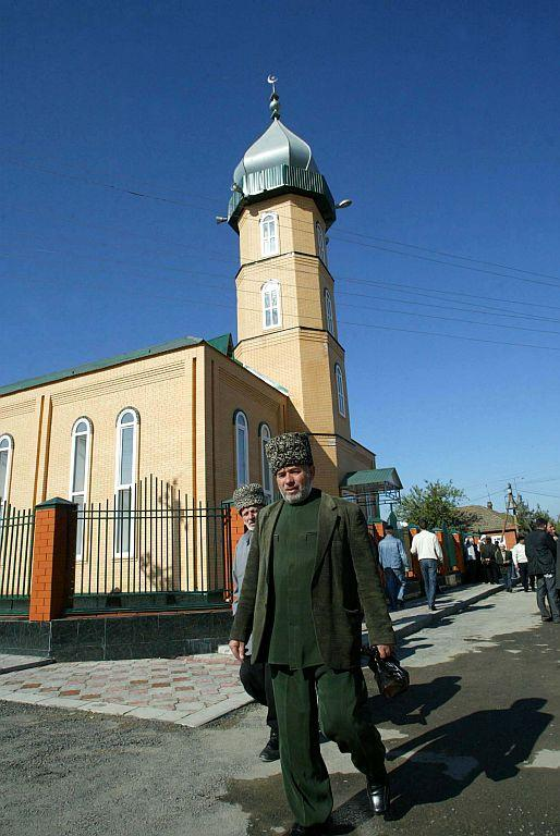 <p>GROZNY, RUSSIA: Men walk in front of the mosque after prayer in Grozny, Chechen Republic, Russia.</p>