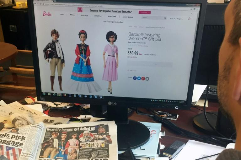 "A journalist looks at the new series Barbie ""Inspiring Women"", featuring (L-R) Amelia Earhart, Frida Kahlo and Katherine Johnson that honors three historic figures who each made a major mark on the world on March 7, 2018 in New York"