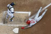 St. Louis Cardinals' Tyler O'Neill scores past Milwaukee Brewers catcher Omar Narvaez during the fourth inning of a baseball game Sunday, Sept. 5, 2021, in Milwaukee. O'Neill scored on a single by Harrison Bader. (AP Photo/Morry Gash)