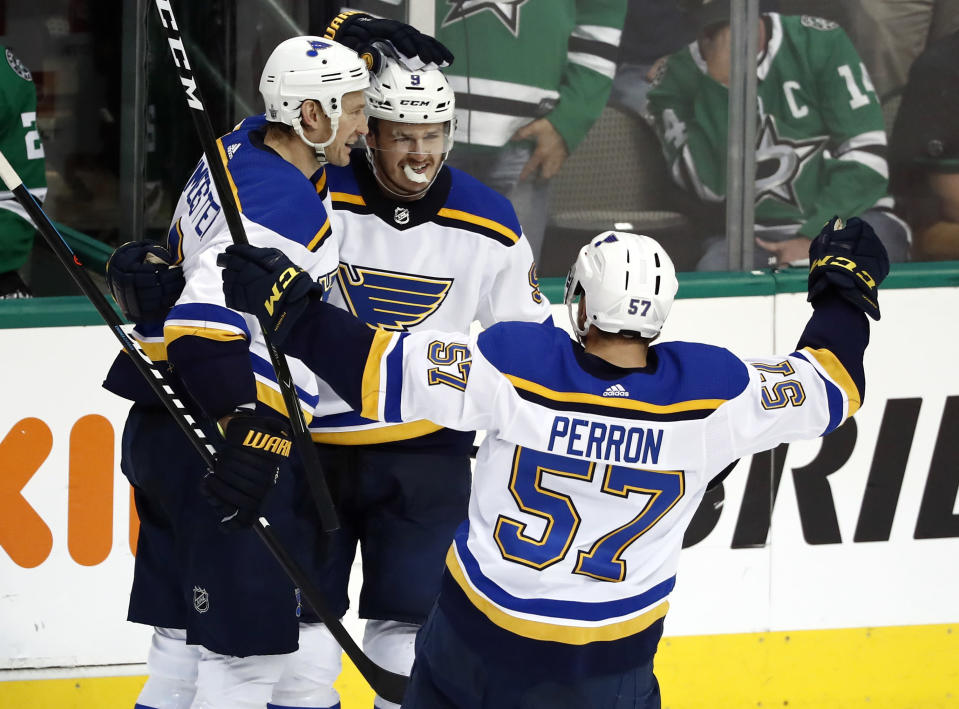 St. Louis Blues' Sammy Blais is congratulated by teammates Jay Bouwmeester, left, and David Perron (57) after scoring during the third period in Game 6 of an NHL second-round hockey playoff series against the Dallas Stars, Sunday, May 5, 2019, in Dallas. The Blues won 4-1. (AP Photo/Tony Gutierrez)