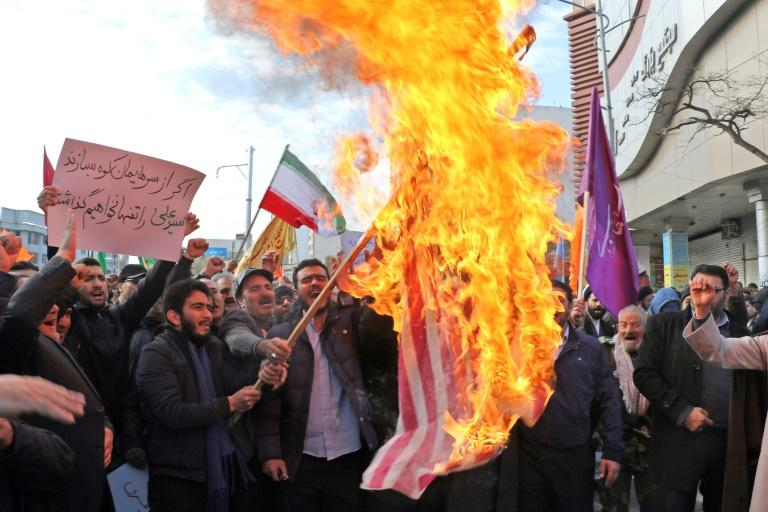 Iranian men burn a US flag during a protest in support of the Islamic republic's government and supreme leader, Ayatollah Ali Khamenei, in the northwestern city of Ardabil (AFP Photo/STR)