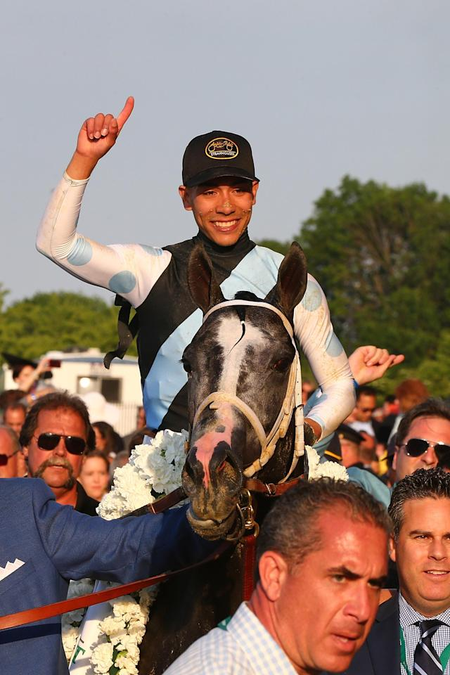 Jose Ortiz celebrates after winning the 149th Belmont Stakes on Tapwrit (AFP Photo/Mike Stobe)
