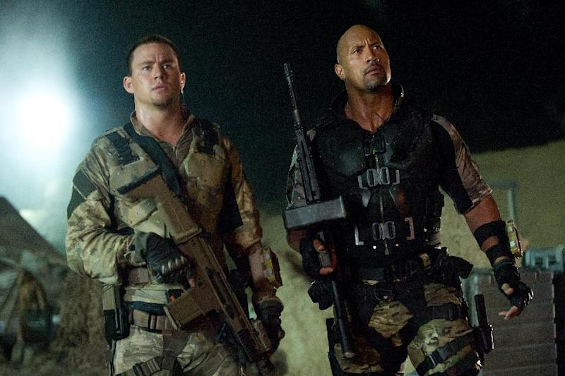 """This film image released by Paramount Pictures shows Channing Tatum, left, and Dwayne Johnson in a scene from """"G.I. Joe: Retaliation."""" (AP Photo/Paramount Pictures, Jaimie Trueblood)"""