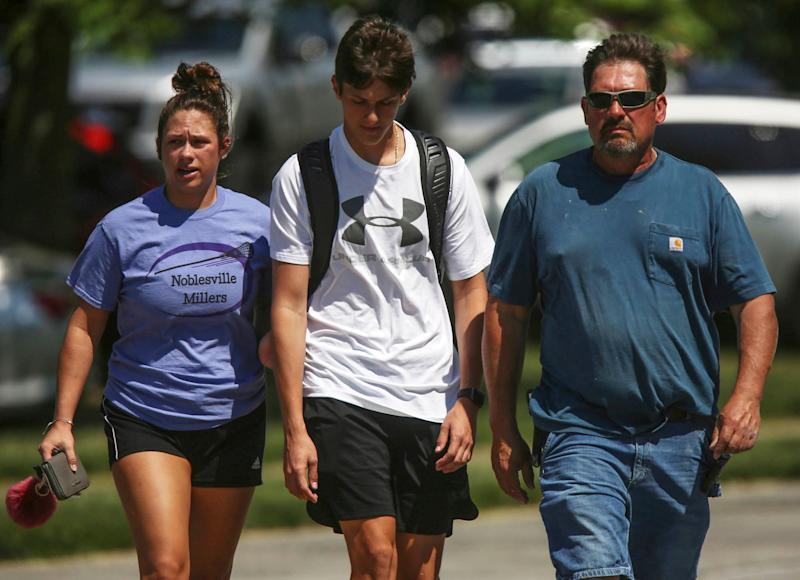 Students near the school after the attempted shooting yesterday: AP