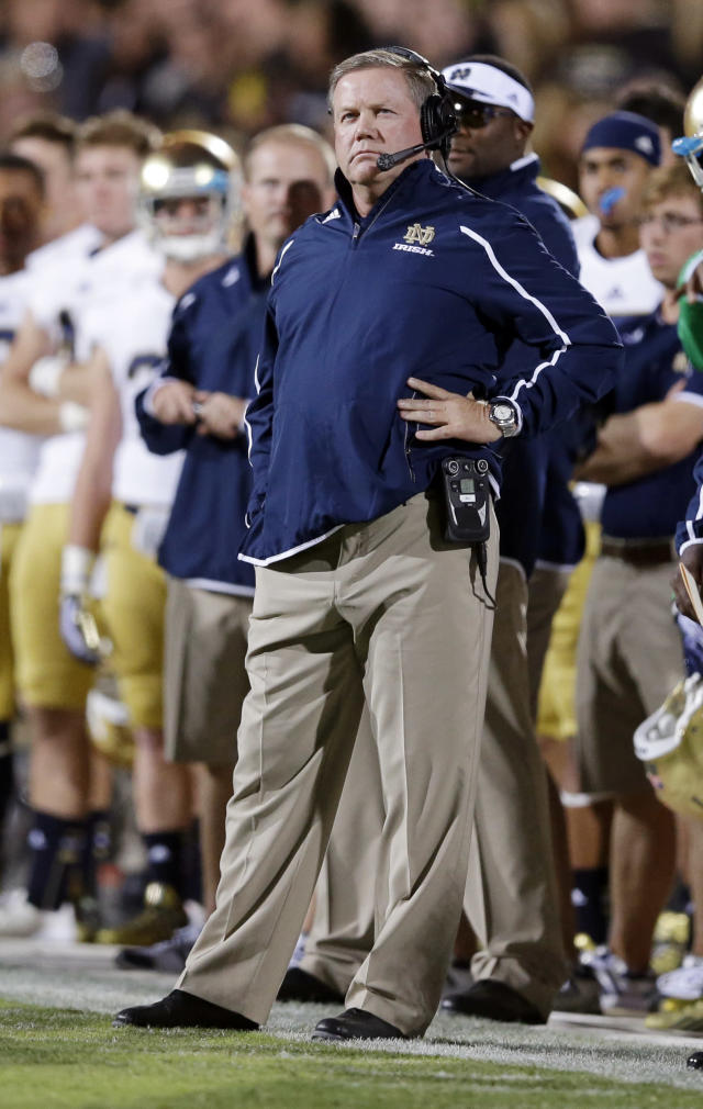 Notre Dame coach Brian Kelly watches a replay as his team played Purdue during the first half of an NCAA college football game in West Lafayette, Ind., Saturday, Sept. 14, 2013. (AP Photo/Michael Conroy)
