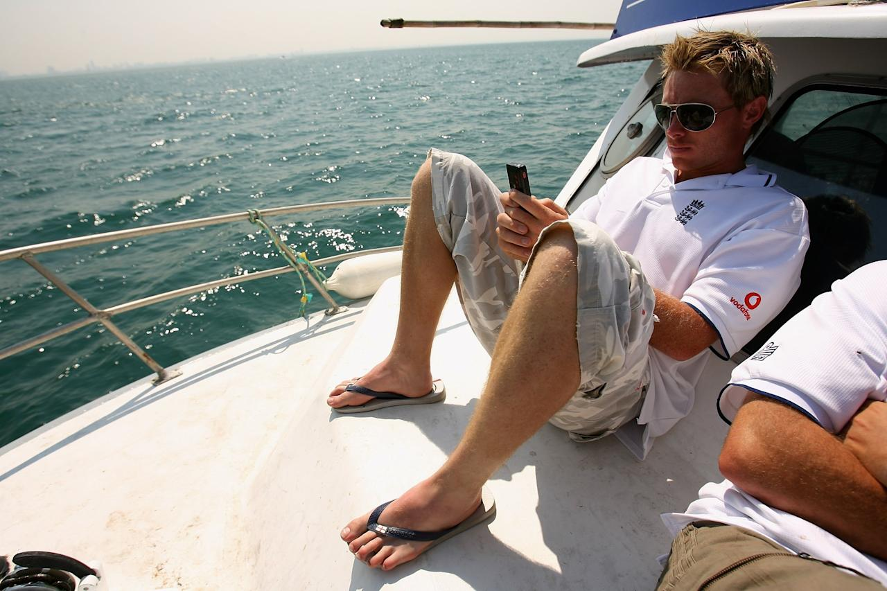 MELBOURNE, AUSTRALIA - DECEMBER 21:  Ian Bell of England uses his mobile phone during a fishing trip in Port Philip Bay, on December 21, 2006 in Melbourne, Australia.  (Photo by Tom Shaw/Getty Images)
