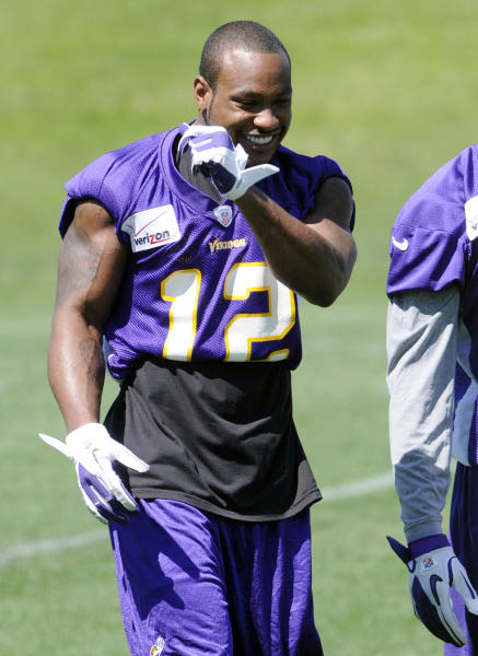 Minnesota Vikings wide receiver Percy Harvin enjoys a laugh during NFL football practice, Thursday, June 21, 2012, in Eden Prairie, Minn. Harvin has asked to be traded, saying earlier in the week he was upset with the team but not elaborating. (AP Photo/Jim Mone)