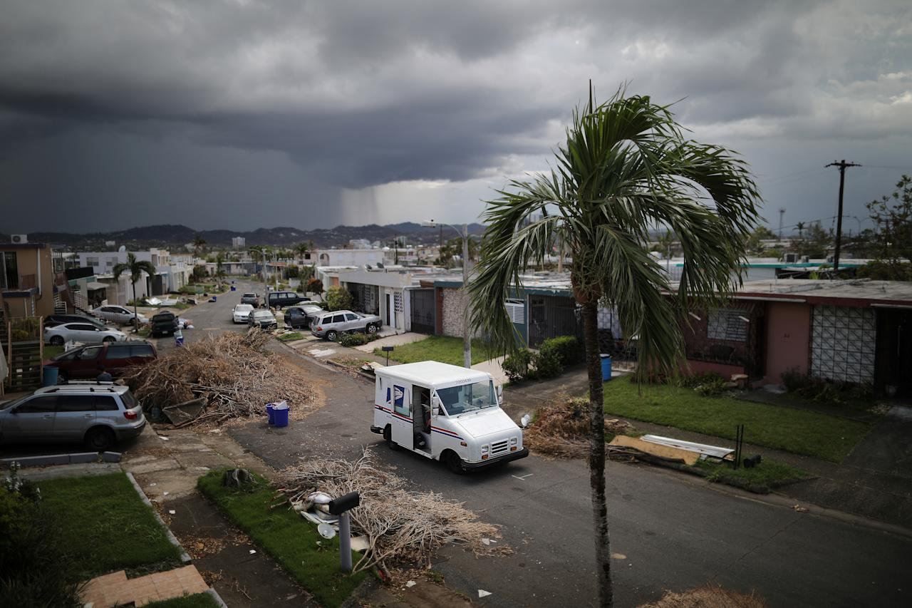 <p>A U.S. Postal Service truck is seen at an area damaged by Hurricane Maria in San Juan, Puerto Rico, in the island of Vieques, Puerto Rico, Oct. 6, 2017. (Photo: Carlos Barria/Reuters) </p>