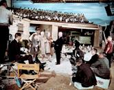 <p>Rod Taylor, Tippi Hedren, and Jessica Tandy take direction from Alfred Hitchcock on the set of The Birds. </p>