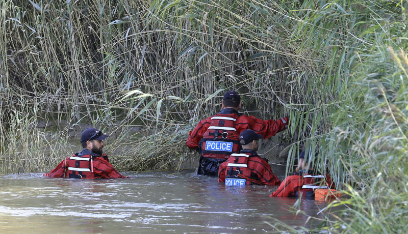 "Police officers search the bank of the River Stour during search operations for the missing six-year old boy, Lucas Dobson, who fell into the river Saturday and was swept away while on a fishing trip with family members, in Sandwich, southern England, Monday Aug. 19, 2019. The search for the six-year-old boy resumed Monday, but police have said it is ""unlikely"" he will be found alive. (Gareth Fuller/PA via AP)"