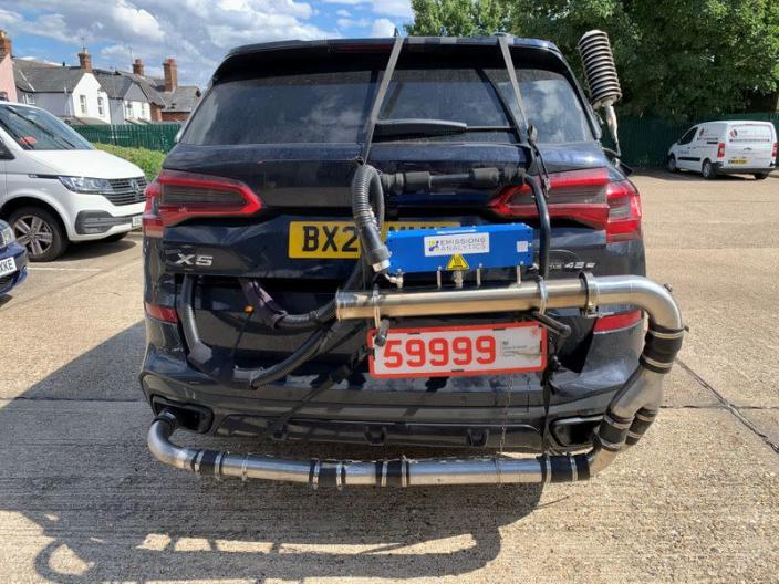 A BMW X5 plug-in hybrid is pictured while undergoing tests by Emissions Analytics for a study on emissions by NGO Transport & Environment