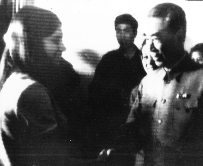 FILE - In this April 14, 1971, handout, United States table tennis team member Judy Bochenski, 15, left, then-known as Judy Hoarfrost, shakes hands with former China Premier Chow En-Lai in Peking, Communist China. Tossed into the middle of a slow thawing in U.S. relations with China, Judy Bochenski and her American ping pong teammates helped deliver perhaps the greatest diplomatic coup of their time. (AP Photo/File)